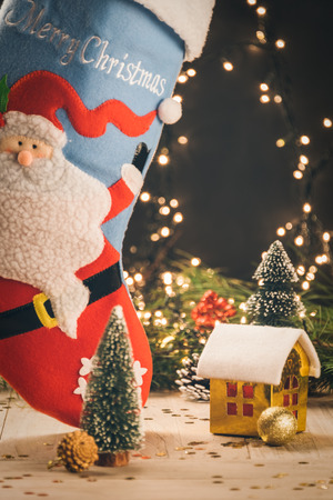 christmas decorations with big christmas stockings and small toy house stock photo 65950188