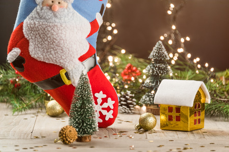 christmas decorations with big christmas stockings and small toy house stock photo 65950308
