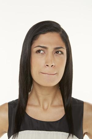 unsure: Woman looking unsure Stock Photo