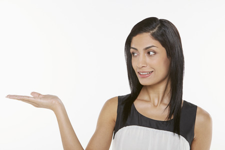 facing right: Woman showing hand gesture, facing right
