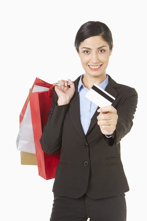 Businesswoman holding shopping bags and a credit card photo