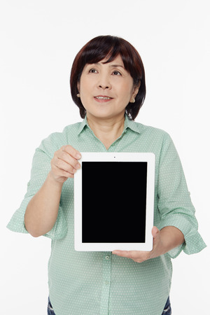 Woman holding up a digital tablet