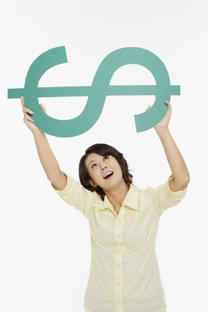 Woman lifting up a dollar sign