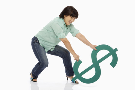 Woman trying to lift up the dollar sign