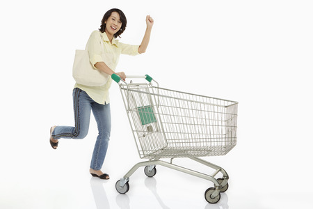 Woman pushing a shopping cart photo