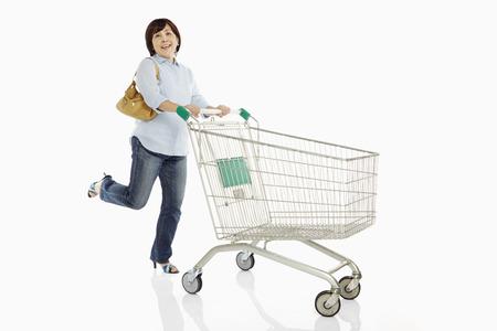 Woman pushing a shopping cart photo