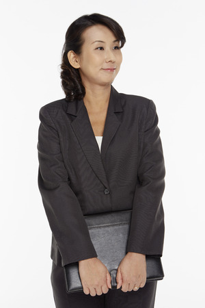 Businesswoman holding a folder 写真素材