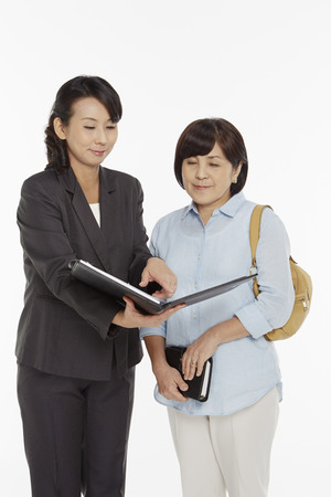 Businesswomen taking a look at the folder