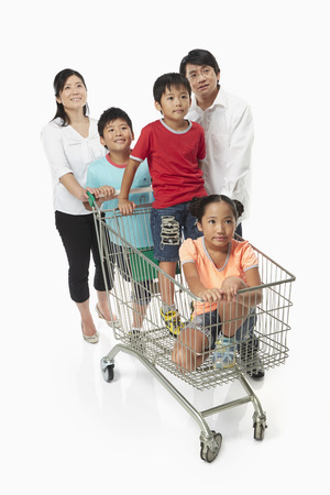 Family of five shopping together photo
