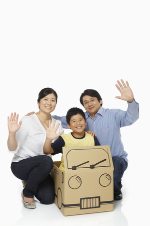 Family of three waving at the camera photo