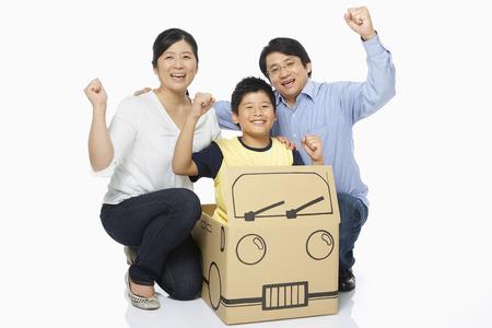 Family of three cheering photo