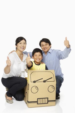 Family of three showing hand gesture photo