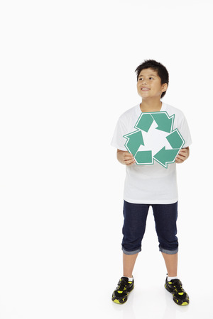 recycle logo: Boy holding up a Recycle logo
