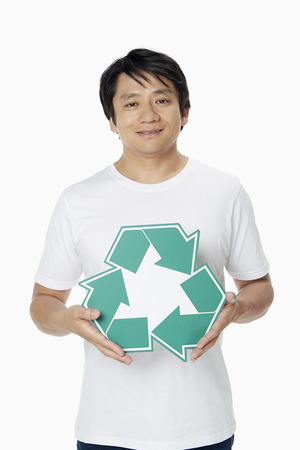 recycle logo: Man showing a Recycle logo Stock Photo