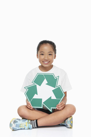 recycle logo: Girl with a Recycle logo smiling at the camera