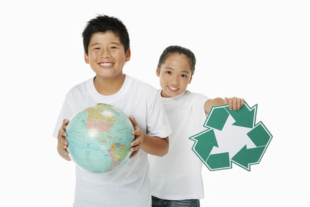 recycle logo: Two children holding up a globe and a Recycle logo Stock Photo