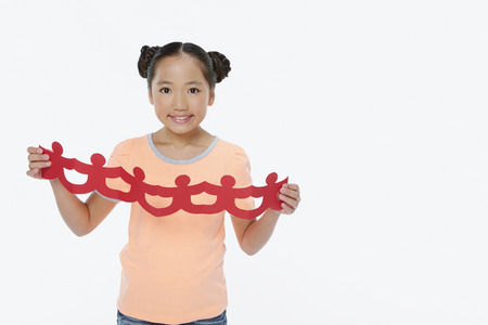 Cheerful girl with a human paper chain photo