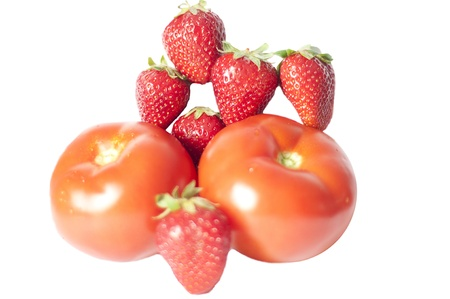 strawberry and tomato isolated on white background photo
