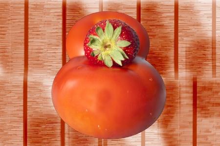 strawberry and tomato isolated on woody background photo