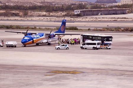 canarias: LAS PALMAS GRAN CANARIAS,SPAIN - JUL 23  Passengers boarding the plane of the ISLAS airline Las Palmas airport,23-07-2012 , Gran Canarias,Spain Editorial