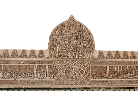 Detailed background of the intricate patterns on a wall of the Nasrid Palace, Alhambra, Granada, Spain photo