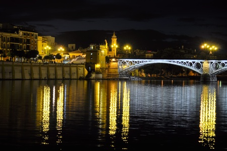 triana neighborhood and river at night in seville Stock Photo