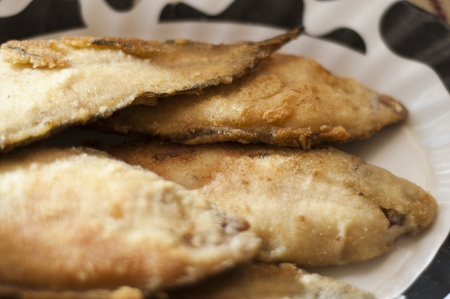 plaice: breaded and  Frying plaice fish on a plate Stock Photo