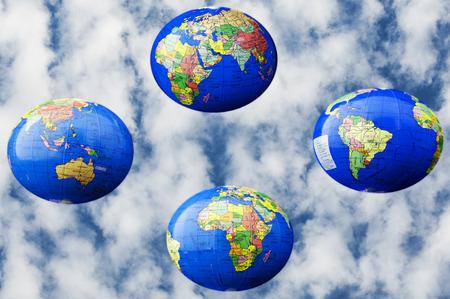 mundi: 4 blobes,mappa mundi, with blue sky as background
