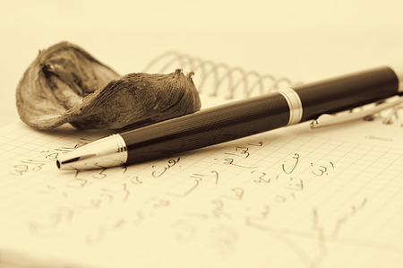 written communication: pen,pink, and letter with sepia toned Stock Photo