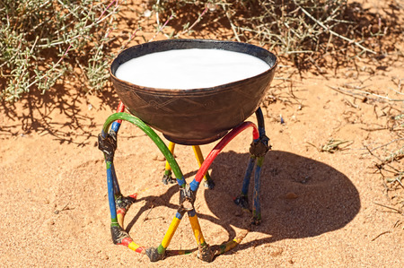 sued: wooden bowl for milk sued by Bedouin in sahara Stock Photo