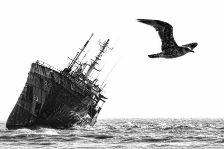 beached: Abandoned broken ship-wreck beached on rocky ocean , b&w, western sahara coast