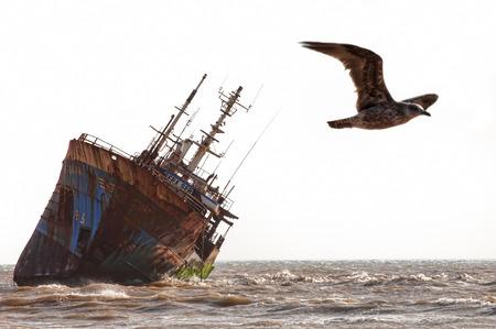 beached: Abandoned broken ship-wreck beached on rocky ocean , western sahara coast Stock Photo