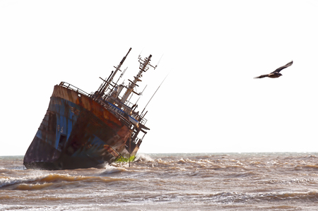 Abandoned broken ship-wreck beached on rocky ocean , western sahara coast Editorial