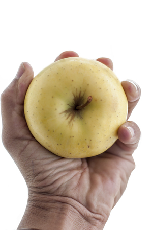 hand holding  an apple iagainst white background