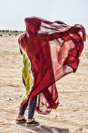 young nomad girl with melhfa in western sahara Stock Photo