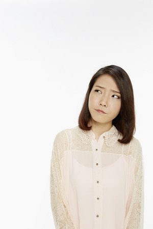 sceptical: Woman with an unsure look on her face