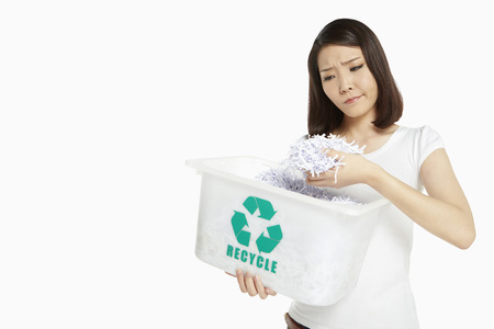 Woman holding up pieces of shredded paper photo