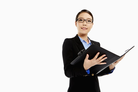 Businesswoman reading notes from a folder photo