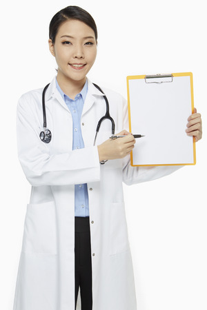 medical personnel: Medical personnel holding up a clipboard Stock Photo