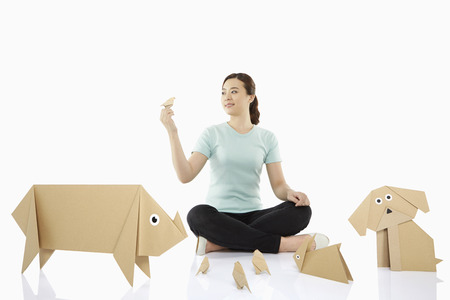 Woman with an assortment of paper animals photo