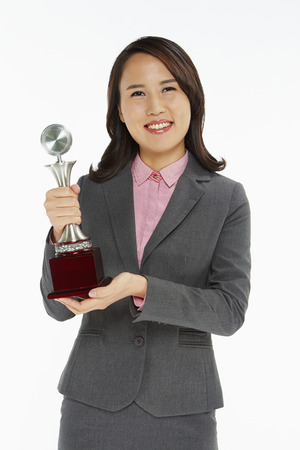 Businesswoman holding a trophy photo