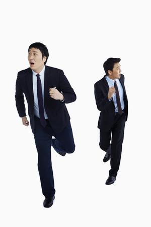 businessman running: Two businessmen on the run