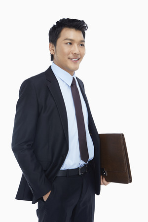 Cheerful businessman holding a briefcase photo