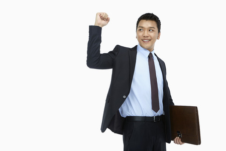 Businessman smiling and cheering photo