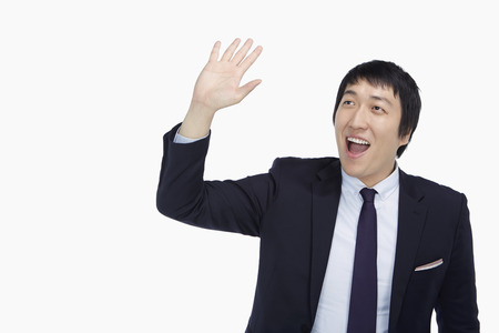 Businessman showing a waving gesture