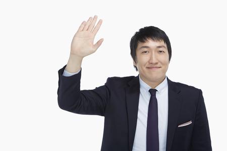 Businessman showing a waving gesture photo