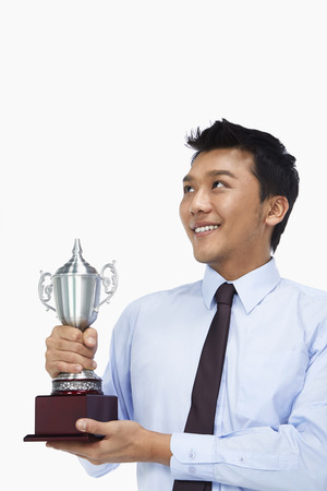 Businessman with a trophy photo