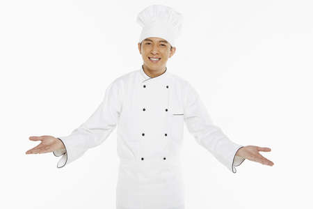 Chef showing a welcome hand gesture photo