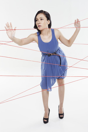 Woman trapped in between tangled wires photo
