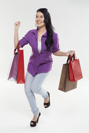 Woman carrying shopping bags photo